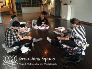 Moms massage their babies at Breathing Space